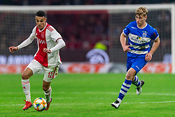 13-03-2019 NED: Ajax - PEC Zwolle, Amsterdam<br /> Ajax has booked an oppressive victory over PEC Zwolle without entertaining the public 2-1 / Noussair Mazraoui #12 of Ajax, Zian Flemming #14 of PEC Zwolle