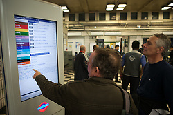 London Underground 48 hour Tube Strike. Commuters check before traveling an information panel for the London Underground which is running a limited service due to industrial action on Embankment Tube station during the 48-hour tube strike at Central London, United Kingdom. Tuesday, 29th April 2014. Picture by Daniel Leal-Olivas / i-Images