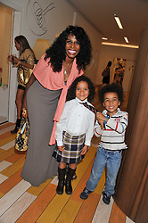 Singer SINITTA and her children ZAC and MAGDALENA at a party to celebrate the opening of Purple Dragon - A new family members club at Grosvenor Waterside, 30 Gatliff Road, London SW1 on 29th September 2011.