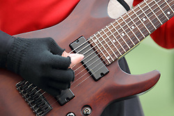 04 October 2014: A gloved hand picks the six string guitar during an NCAA FCS Missouri Valley Football Conference game between the South Dakota State Jackrabbits and the Illinois State University Redbirds at Hancock Stadium in Normal Illinois
