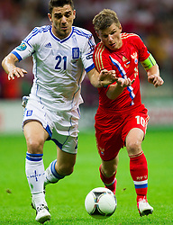 16-06-2012 VOETBAL: UEFA EURO 2012 DAY 9: POLEN OEKRAINE<br /> Kostas Katsouranis  of Greece vs Andrey Arshavin of Russia during the UEFA EURO 2012 group A match between  Greece and Russia at The National Stadium<br /> ***NETHERLANDS ONLY***<br /> ©2012-FotoHoogendoorn.nl