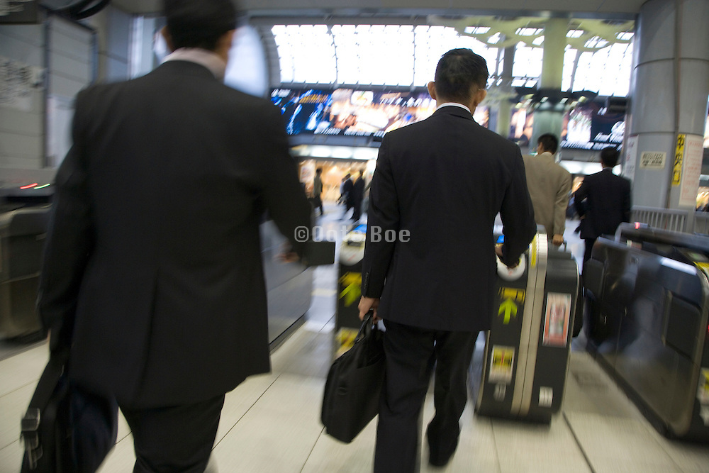 business commuters rushing through the turnstile Japan Tokyo