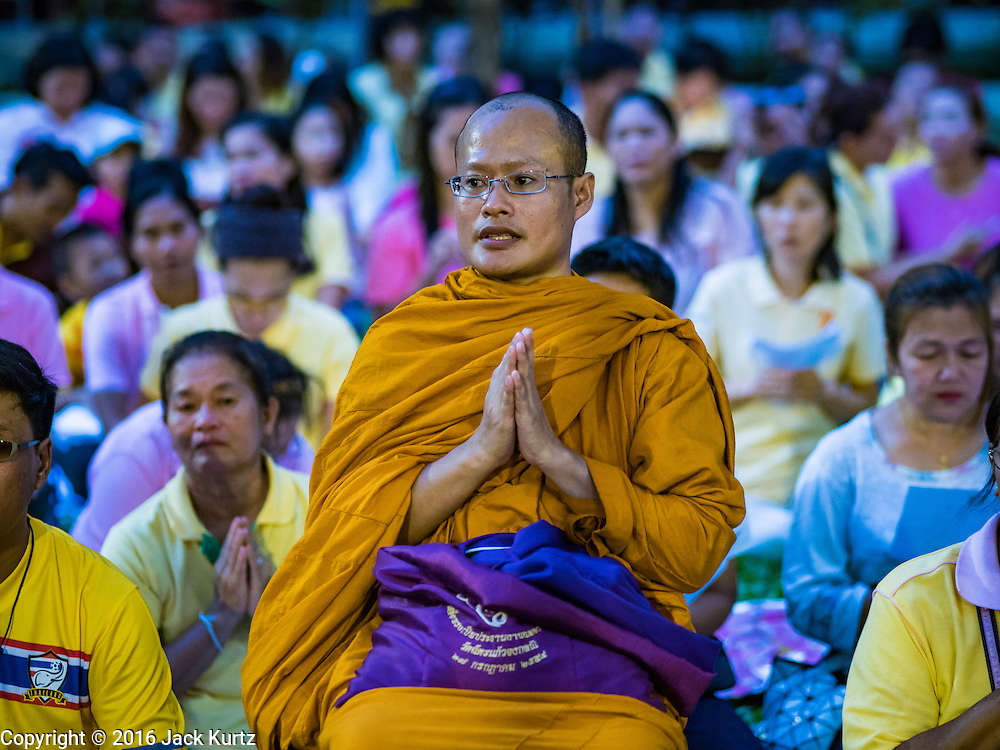 13 OCTOBER 2016 - BANGKOK, THAILAND: A monk prays for the King of Thailand after the revered monarch's death at Siriraj Hospital. Thousands of people came to the hospital to pray for the beloved monarch. Bhumibol Adulyadej, the King of Thailand, died at Siriraj Hospital in Bangkok Thursday, October 13, 2016. Bhumibol Adulyadej, 5 December 1927 – 13 October 2016, was the ninth monarch of Thailand from the Chakri Dynasty and is known as Rama IX. He became King on June 9, 1946 and served as King of Thailand for 70 years, 126 days. He was, at the time of his death, the world's longest-serving head of state and the longest-reigning monarch in Thai history.       PHOTO BY JACK KURTZ