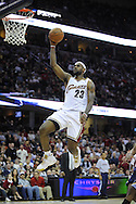 LeBron James goes up for a slam dunk against the Memphis Grizzlies.