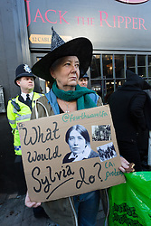 "© Licensed to London News Pictures. 31/10/2015. London, UK. Demonstrators protest outside the Jack the Ripper Museum in Cable Street, Shadwell, east London. The protest is organised by feminist group, The Fourth Wave and attended by Class War and other activists, who are protesting against a Halloween event being held at the museum this weekend, where visitors can take selfie photographs inside the museum with ""Jack the Ripper"" and some of his female victims played by actors. Photo credit : Vickie Flores/LNP"