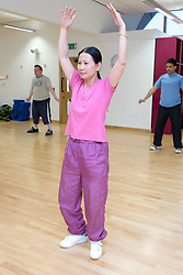 Woman taking part in an aerobics class at her sports leisure centre,