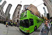 Seattle Sounders players including goalkeeper Stefan Frei, right, hold up the MLS Cup trophy and wave to fans during the MLS Cup Champions Parade & Rally on November 12, 2019 in Seattle, Washington, to celebrate the Sounders' win over Toronto FC to win the MLS Cup soccer match in Seattle. (Alika Jenner/Image of Sport)