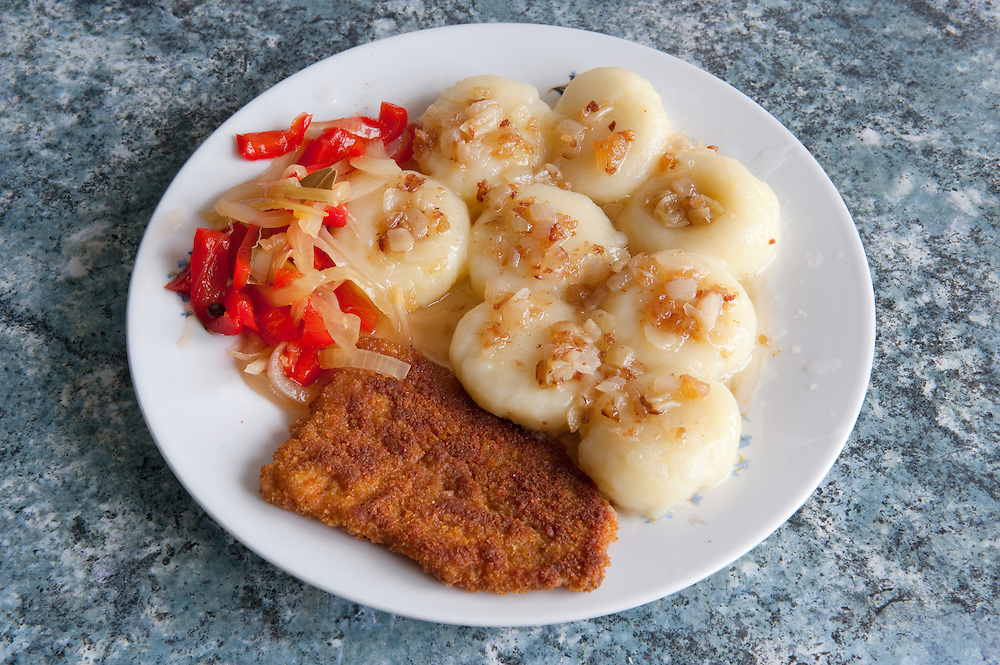 Silesian potato dumplings - Kluski śląskie<br /> Serves 2 <br /> <br /> Ingredients: 1 bag of frozen Silesian potato dumplings <br /> 2 tablespoons lard <br /> 1 small onion<br /> <br /> Preparation :<br /> 1.Put the dumplings in a saucepan with boiling water <br /> 2.When they come to the surface reduce heat and simmer for 10mins<br /> 3.Strain the dumplings <br /> 4.Cut the lard and the onion into small cubes and fry them<br /> 5.Put the lard and the fried onion over the dumplings and serve<br /> <br /> Fish cutlet – Ryba Smażona<br /> Serves 2 for 3 days <br /> <br /> Ingredients: 1 glass of flour<br /> 1 glass of bread crumbs <br /> 6 fish fillets (Panga) <br /> I tablespoon of ready-mix fish spices<br /> 1 egg<br /> vegetable oil<br /> <br /> Preparation :<br /> 1.Sprinkle the spices on the fish fillets<br /> 2.Flour the fillet, then put them on the egg and them crumb them<br /> 3.Place enough vegetable oil on a pan to cover the fillets<br /> 4.Fry the fish for 10mins and turn occasionally <br /> <br /> Red pepper pickle<br /> Serves 2 for months  <br /> <br /> Ingredients: 4kg red bell peppers<br /> 2Kg onions glass of bread crumbs <br /> ½litre vinegar  <br /> 90gr salt<br /> 300gr sugar<br /> 1½litre water<br /> 4-5 bay leafs  <br /> 10-15 grains allspice <br /> <br /> Preparation :<br /> 1.Cut the peppers and take out the seeds<br /> 2.Slice them and salt them<br /> 3.Then slice the onions and salt them <br /> 4.Put them on separate bowls and leave them for 12hrs<br /> 5.Then squeeze them so the juices will come out<br /> 6.In a large saucepan boil water with vinegar and the other ingredients<br /> 7.When the water boils add the peppers and the onion<br /> 8.Boil them in high fire for 10-15mins <br /> 9.Then put them hot in jars and close the lid immediately to create vacuum <br /> 10.Store them and use them in the winter