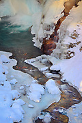 Frozen and snowy creek below Christine Falls in Mount Rainier National Park in winter
