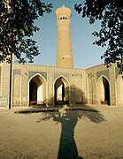 Central Asia's tallest minaret, the Kalon Minaret, shot from the Kalon Mosque, Bukhara, on the ancient Silk Road.  Uzbekistan.