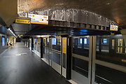 """March, 19th, 2020 - Paris, Ile-de-France, France: Empty Paris Metro, on the third day of a near total lockdown imposed in France. All journeys outside the home unless justified for essential professional or health reasons are outlawed. Anyone flouting the new regulations is punished with monetary fines. French police control of citizens and inspection of valid papers allowing citizens to travel. The most extreme measures so far in France to control the spread of the Coronavirus. Earlier in the week, President of France, Emmanuel Macron, said that citizens must stay at home from midday on Tuesday for at least 15 days. He said """"We are at war, a public health war, certainly but we are at war, against an invisible and elusive enemy"""". Nigel Dickinson"""