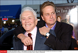 Kirk Douglas Dies At 103 - © Lionel Hahn/ABACA. 44421-7. Los Angeles-CA-USA. 04/07/03. Cast members Michael Douglas and his father Kirk Douglas attend the premiere of It Runs In The Family at the Mann Bruin Theatre in Westwood.