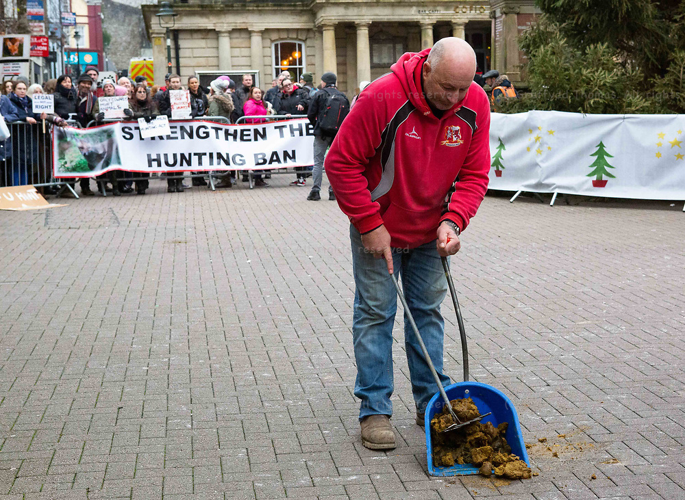 Carmarthen, UK. 1 January, 2020.<br /> The Carmarthenshire Hunt meets anti-hunt protesters in Carmarthen town centre on New Year's Day.<br /> Credit: Gruffydd Ll. Thomas