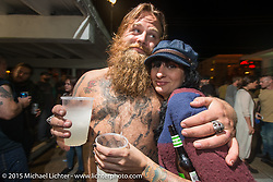Dumptruck Stroupe and Corinna Mantlo at the Harley-Davidson sponsored Friday evening party in the hotel parking lot before the Race of Gentlemen. Wildwood, NJ, USA. October 9, 2015.  Photography ©2015 Michael Lichter.