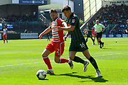 Oliver Turton (2) of Crewe Alexandra battles for possession with Matthew Kennedy (16) of Plymouth Argyle during the EFL Sky Bet League 2 match between Plymouth Argyle and Crewe Alexandra at Home Park, Plymouth, England on 29 April 2017. Photo by Graham Hunt.