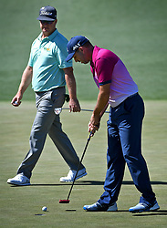 Sergio Garcia, right, prepares to putt on the second green as Charley Hoffman, left, walks behind him during the third round of the Masters Tournament at Augusta National Golf Club in Augusta, Ga., on Saturday, April 8, 2017. (Photo by Jeff Siner/Charlotte Observer/TNS) *** Please Use Credit from Credit Field ***