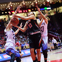 Gallup Bengal Hanna Toledo (13), center attempts a layup ahead of Bloomfield Bobcats Sierra Ortiz (25), left, Kimberlyn Morgan (23) during a District 5A semifinal at The Pit in Albuquerque Thursday.  The Bengals fell to the Bobcats 59-56.