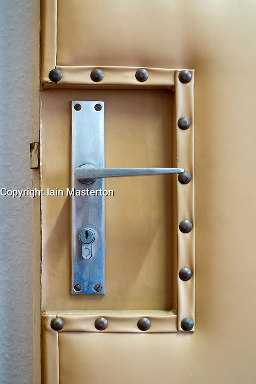 Detail of padded security door in offices of East German secret Police now STASI Museum in Berlin Germany