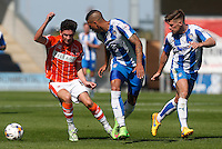 Blackpool's Henry Cameron despite the attentions of  Colchester United's Matthew Briggs<br /> <br /> Photographer  Kieran Galvin/CameraSport<br /> <br /> Football - The Football League Sky Bet League One - Colchester United v Blackpool - Saturday 08th August 2015 - Weston Homes Community Stadium - Colchester<br /> <br /> © CameraSport - 43 Linden Ave. Countesthorpe. Leicester. England. LE8 5PG - Tel: +44 (0) 116 277 4147 - admin@camerasport.com - www.camerasport.com