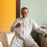Drinking tea in Thủy Phư commune. Village life includes much visiting of family and neighbors during the long hot afternoons.