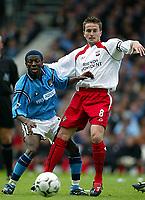 Photo Aidan Ellis.<br />Manchester City v Southampton (FA Barclaycard Premiership).11/05/2003.<br />City's Shaun Wright Phillips and Southampton's Matt Oakley
