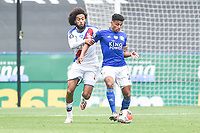 LEICESTER, ENGLAND - JULY 04: James Justin of Leicester City holds off Jairo Riedewald of Crystal Palace during the Premier League match between Leicester City and Crystal Palace at The King Power Stadium on July 4, 2020 in Leicester, United Kingdom. Football Stadiums around Europe remain empty due to the Coronavirus Pandemic as Government social distancing laws prohibit fans inside venues resulting in all fixtures being played behind closed doors. (Photo by MB Media)