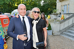 JOHAN ELIASCH and AMANDA ELIASCH at the Quintessentially Foundation and Elephant Family 's 'Travels to My Elephant' Royal Rickshaw Auction presented by Selfridges and hosted by HRH The Prince of Wales and The Duchess of Cornwall held at Lancaster House, Cleveland Row, St.James's, London on 30th June 2015.