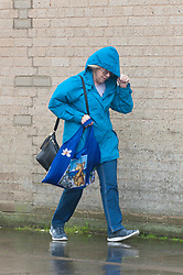 © Licensed to London News Pictures. 04/10/2019. Porthcawl, Bridgend, Wales, UK. People are battered by the strong wind and rain as Storm Lorenzo, named after ex-hurricane Lorenzo, by Met Éireann, hits the Welsh seaside resort of Porthcawl in Bridgend, UK. Photo credit: Graham M. Lawrence/LNP