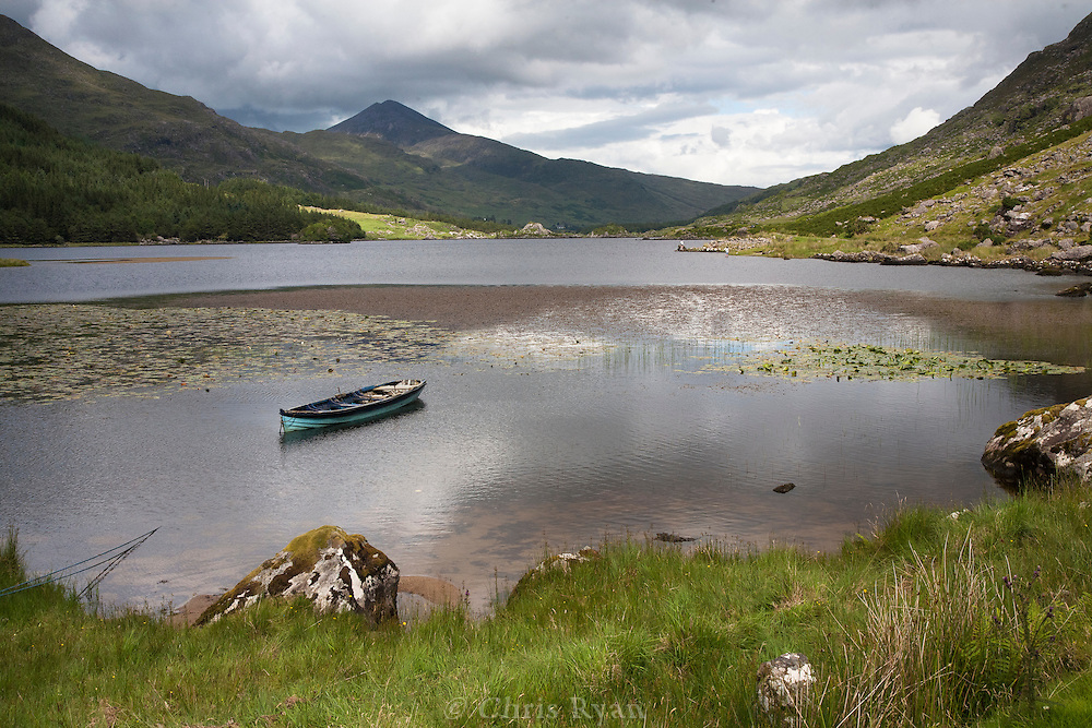 Lone fishing boat on Cummeenduff Lake in the Black Valley, County Kerry, Ireland