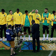 Football - Olympics: Day 15  Neymar #10 of Brazil reacts after receiving his gold medalon the podium during the Brazil Vs Germany Men's Football Gold Medal Match at Maracana on August 20, 2016 in Rio de Janeiro, Brazil. (Photo by Tim Clayton/Corbis via Getty Images)
