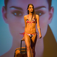 Modell presents a swimsuite during the annual Cosmopolitan Bikini Show held at Millenaris Teatrum.