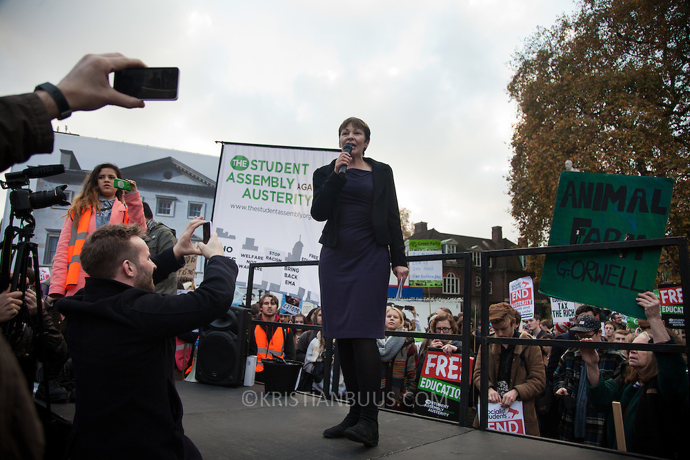 Caroline Lucas, MP Green Party. At the rally outside Parliament. Thousands of students turned out to a march against fees and cuts in the education sector, calling for workers and students to unite against the Government's austerity policies.