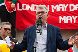 London, UK. 1st May, 2019. Mick Cash, General Secretary of the RMT trade union, addresses representatives of trade unions and socialist and communist parties from many different countries attending the annual May Day rally in Trafalgar Square to mark International Workers' Day.