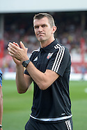 Marinus Dijkhuizen, the Brentford head coach arrives  pitchside before k/o. Skybet football league Championship match, Brentford v Ipswich Town at Griffin Park in London on Saturday 8th August 2015.<br /> pic by John Patrick Fletcher, Andrew Orchard sports photography.