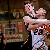 010815       Cable Hoover<br /> <br /> Gallup Bengal Sean Eskeets (23) is fouled by Kirtland Central Bronco Riley Hamblin (10) during the Gallup Boys Invitational at Gallup High School Thursday.