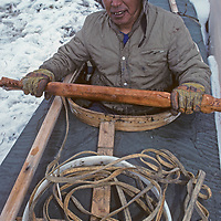 Inuit hunter & kayak maker, Peter Paniloo wears traditional caribou parka, Pond Inlet, Baffin Island, Nunavut, Canada.