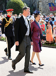 The Princess Royal and Vice Admiral Sir Timothy Lawrence arrive at St George's Chapel at Windsor Castle for the wedding of Meghan Markle and Prince Harry.