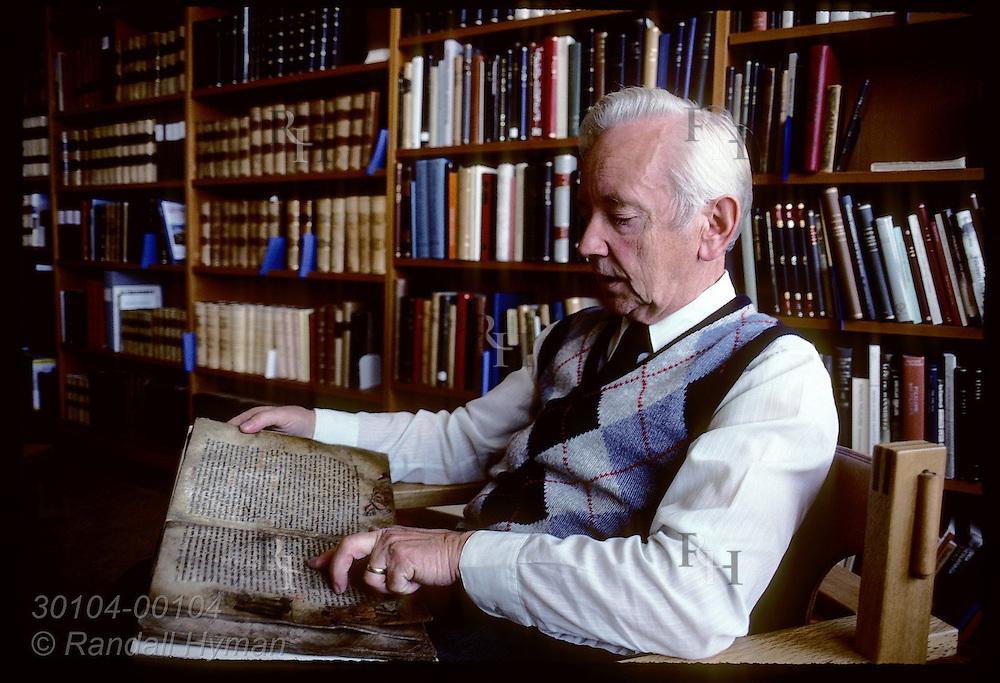 Jonas Kristjansson, Arni Magnusson Institute's director, reads vellum copy of Jonsbok. Iceland