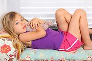 young girl cuddles her teddy bear
