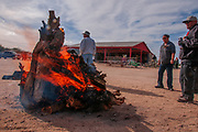 A fire is prepped for a Christmas celebration in the San Xavier District of the Tohono O'odham Reservation, Tucson, Arizona, USA.