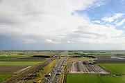 Nederland, Noord-Brabant, Gemeente Moerdijk, 23-10-2013; Infrabundel, combinatie van autosnelweg A16 gebundeld met de reguliere spoorlijn en de HSL ter hoogte van Zevenbergschen Hoek. Foto richting Knooppunt Zonzeel en Breda-Prinsenbeek.<br /> Combination of motorway A16, HST railroad and regular line, Brabant (southern Netherlands)<br /> luchtfoto (toeslag op standard tarieven);<br /> aerial photo (additional fee required);<br /> copyright foto/photo Siebe Swart