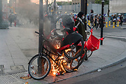 Muslim woman protester with burning barricades of bicycles. Black tuesday commemoration of the deaths of Adama Traore in France and George Floyd in USA. Tribunal de Paris, Paris, June 2, 2020. Photography by Nigel Dickinson/Hans Lucas.<br /> Manifestante musulmane avec des barricades de velos en feu. Mardi noir commemoration de la mort d Adama Traore en France et de George Floyd aux Etats-Unis. Tribunal de Paris, Paris, 2 juin 2020. Photographie par Nigel Dickinson/Hans Lucas.