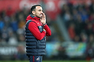 Leon Britton, the Swansea city caretaker manager shouts his instructions to his players. Premier league match, Swansea city v Crystal Palace at the Liberty Stadium in Swansea, South Wales on Saturday 23rd December 2017.<br /> pic by  Andrew Orchard, Andrew Orchard sports photography.
