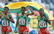 Haile Gebrselassie (426), Kenenisa Bekele (426) and Sileshi Sihine (429 take victory lap after they swept the first three places in the 10,000 meters in the IAAF World Championships in Athletics at Stade de France on Sunday, Aug, 24, 2003.