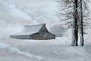 The historic Moulton Barn in Grand Teton National Park during a winter storm. Artistic effects applied by Mike R. Jackson