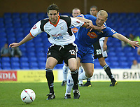 Photo. Aidan Ellis.Digitalsport<br /> Stockport County v Luton Town.<br /> Coca-Cola League Division 1.<br /> 18/09/2004.<br /> Luton's Chris Coyne holds of the challenge from Stockport's Rickie Lambert