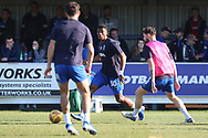 AFC Wimbledon defender Paul Kalambayi (30) and AFC Wimbledon midfielder Anthony Wordsworth (40) warming up during the EFL Sky Bet League 1 match between AFC Wimbledon and Charlton Athletic at the Cherry Red Records Stadium, Kingston, England on 23 February 2019.