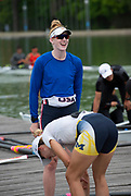 Plovdiv, Bulgaria, 9th May 2019, FISA, Rowing World Cup 1,  W2-, USA, USA2,(s) Emily REGAN, right, with crew mate, (b)Felice MUELLER, bending down, left, on the pontoon.<br /> [© Peter SPURRIER]