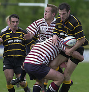 Esher, Surrey. ENGLAND.<br /> <br /> Photo Peter Spurrier<br /> 04/05/2002<br /> Sport - Rugby Union<br /> Tetley's County Championship 1 st Rd<br /> Surrey vs Cornwall<br /> Joe Bearman, is held up by Jim Hayes