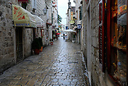 Paved street and store-fronts of Trogir, Croatia